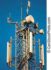 Comunication antenna - Mobile phone mast with a blue sky in...