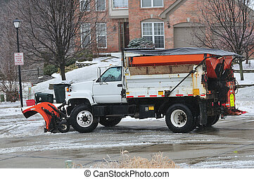 Kentucky Snow Plow - A snow plow cleaning the road in a...