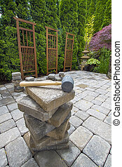 Stack of Pavers on Backyard Garden Patio - Stack of Cement...