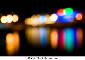 Defocused colored lights reflecting in the water