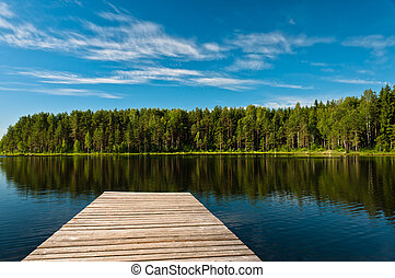 Wooden pier on lake scene