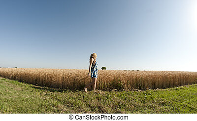 Blonde woman and a wheat field