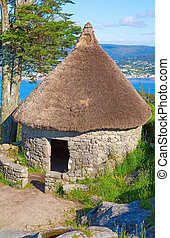 Celtic shack 1 - Vertical composition of Celtic shack in...