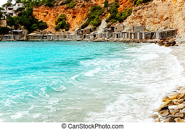 Cala d Hort Ibiza beach with traditional wood mooring