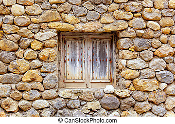 masonry stone wall with grunge wood window - Balearic...