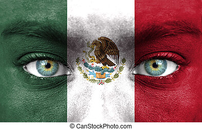 Human face painted with flag of Mexico