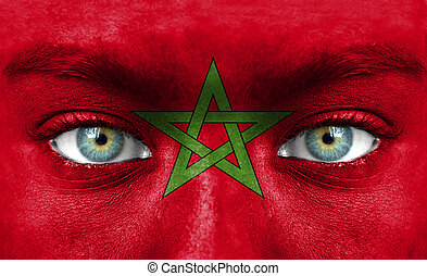 Human face painted with flag of Morocco