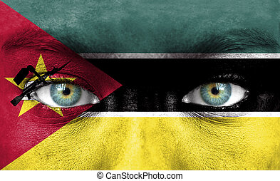 Human face painted with flag of Mozambique