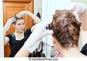Portrait of pretty Caucasian beautiful woman dyeing hairs at...
