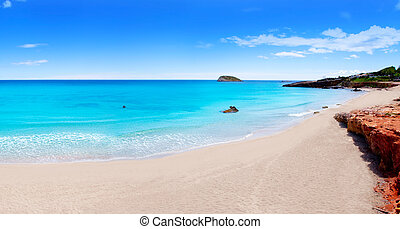 Cala Nova beach in Ibiza island with turquoise water in...