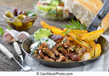 Greek gyros - Greek pork gyros with tzatziki and fried...