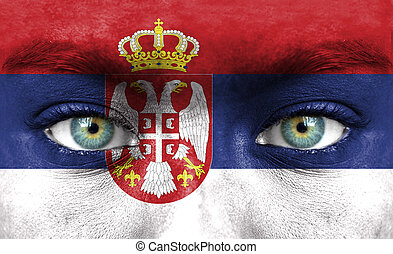 Human face painted with flag of Serbia