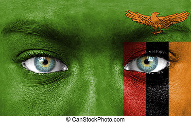 Human face painted with flag of Zambia