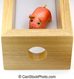 wooden pig find way out of wooden box