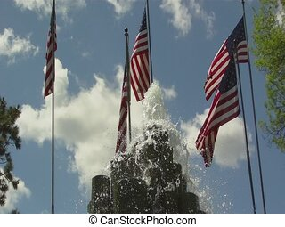 Fountains, American Flags, and Clouds - High angled shot of...