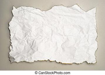 wrinkled burnt paper