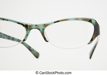 pair of spectacles - pair of green spectacles on dark...