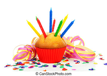 Birthday cupcake with lots of candles, party streamers and colorful confetti over white background