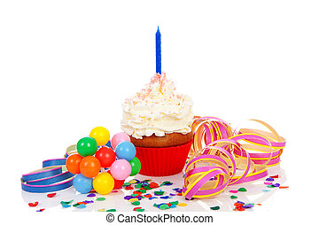 Birthday cupcake with whipped cream, party streamers and colorful confetti over white background