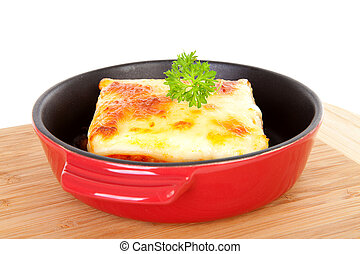 Fresh Lasagna dinner - fresh Lasagna dinner in pan on wooden...