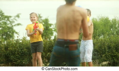 Summer fighters - Children fighting playfully with water...