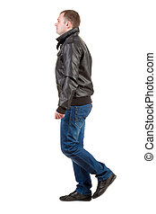 Back view of going  man in jacket.