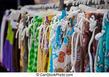 Bathing suit - Market stall offering bathing suits.