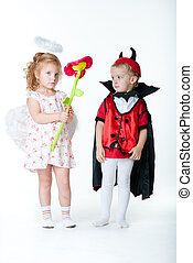 the boy in the image of devil and a girl angel - devil boy...