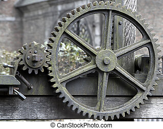 Old, large, rusty, industrial gears - close up view of gears...