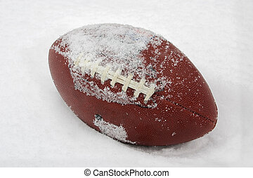 Football in the Snow - a football covered with snow and...