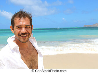 handsome man smiling at beach - close up of young handsome...