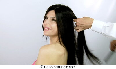 beautiful femal model getting hair - happy smiling woman...