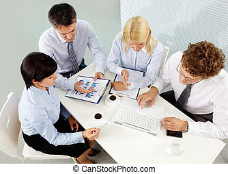 Gathered business people - The above view of office people...