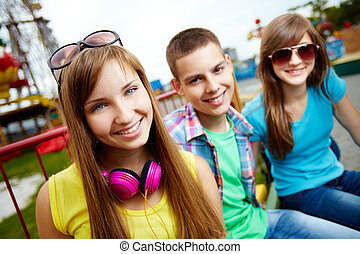Teenage portrait - Teenagers spending time in the amusement...