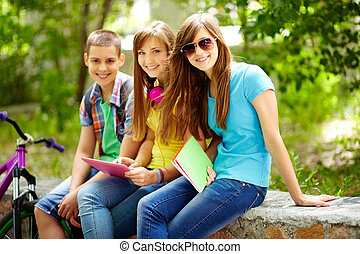 After classes - Three friends enjoying their free time after...