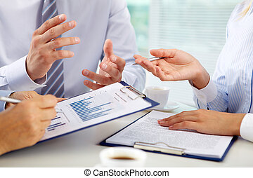 Financial discussion - Business group discussing the present...