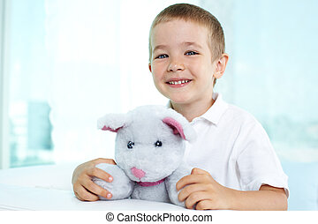 Happy kid - Portrait of a lovely child beaming with...
