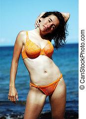 Glamour babe on the beach