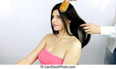 Sexy woman getting hair done