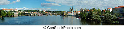 Panorama of old Prague stone bridge over Vltava river, Czech...