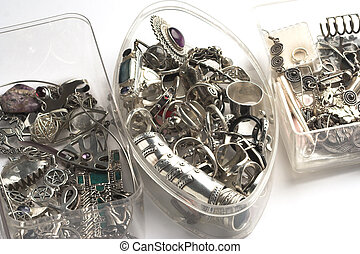 Silver jewelry - Piles of miscellaneous silver jewelry in...