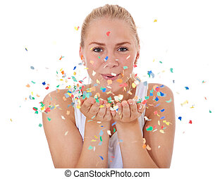 Confetti - Attractive teenage girl having fun with confetti...