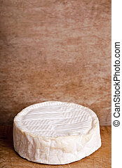 camembert cheese on a wooden background