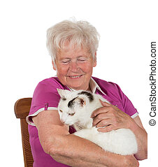 Smiling granny holding her cat - Smiling granny sitting on...