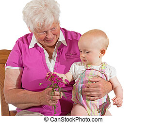 Small baby sitting contentedly with Grandma