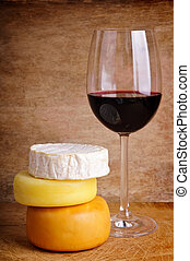 cheese and glass of red wine - glass of red wine with...
