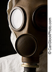Person in gas mask on black background