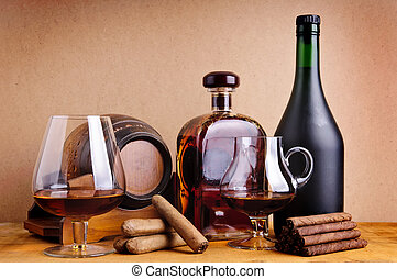 cognac and cigars - still life concept with glass, bottles...