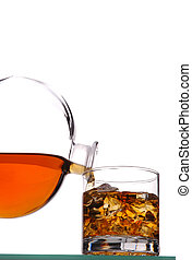 Whiskey Glass and Decanter - Whiskey Pouring from Decanter...