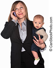 Working Mother on Phone - Female worker on phone holding...
